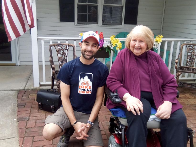 Brian Joseph has family members with MS. He took a break to chat with Mary Namy, one of 3 women with MS who share a home in E