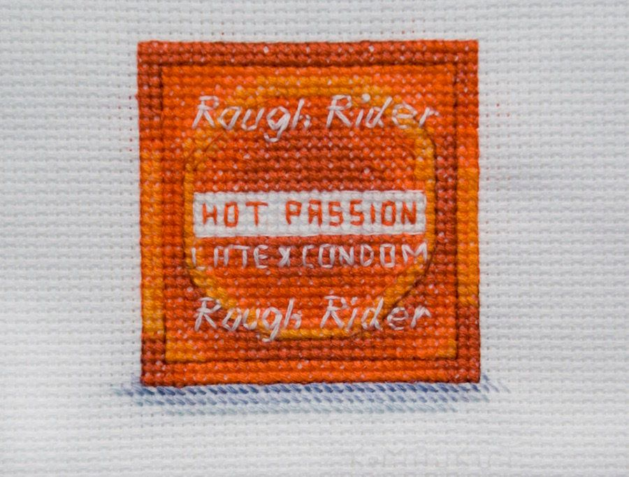 "Katrina Majkut, ""Hot Passion Condom,"" 2015, Thread on cross-stitch fabric, 8 x 8 inches copy"