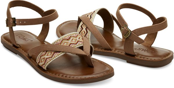 "Buy the <a href=""http://www.toms.com/women/toffee-canvas-embroidery-womens-lexie-sandals"" target=""_blank"">Toms 'Toffee Canvas"