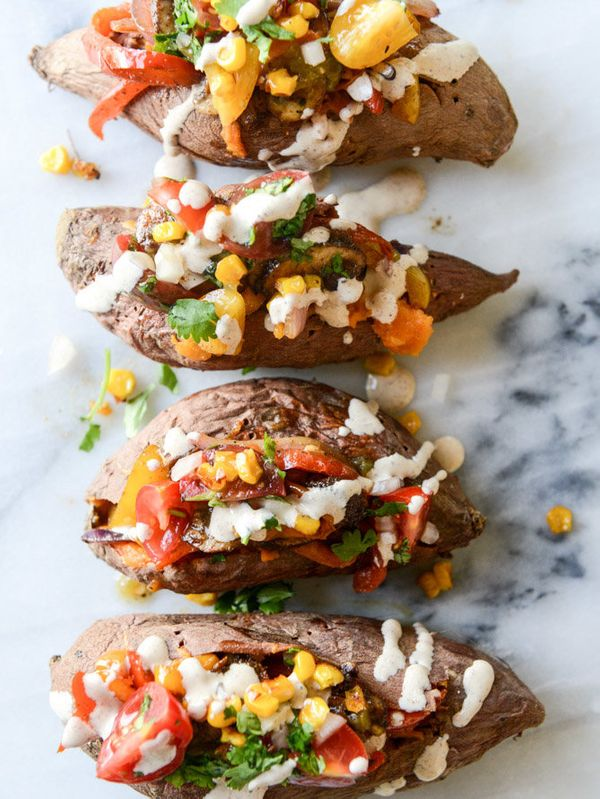 "<strong>Get the <a href=""http://www.howsweeteats.com/2015/09/veggie-fajita-stuffed-sweet-potatoes-with-a-chipotle-drizzle/"" t"