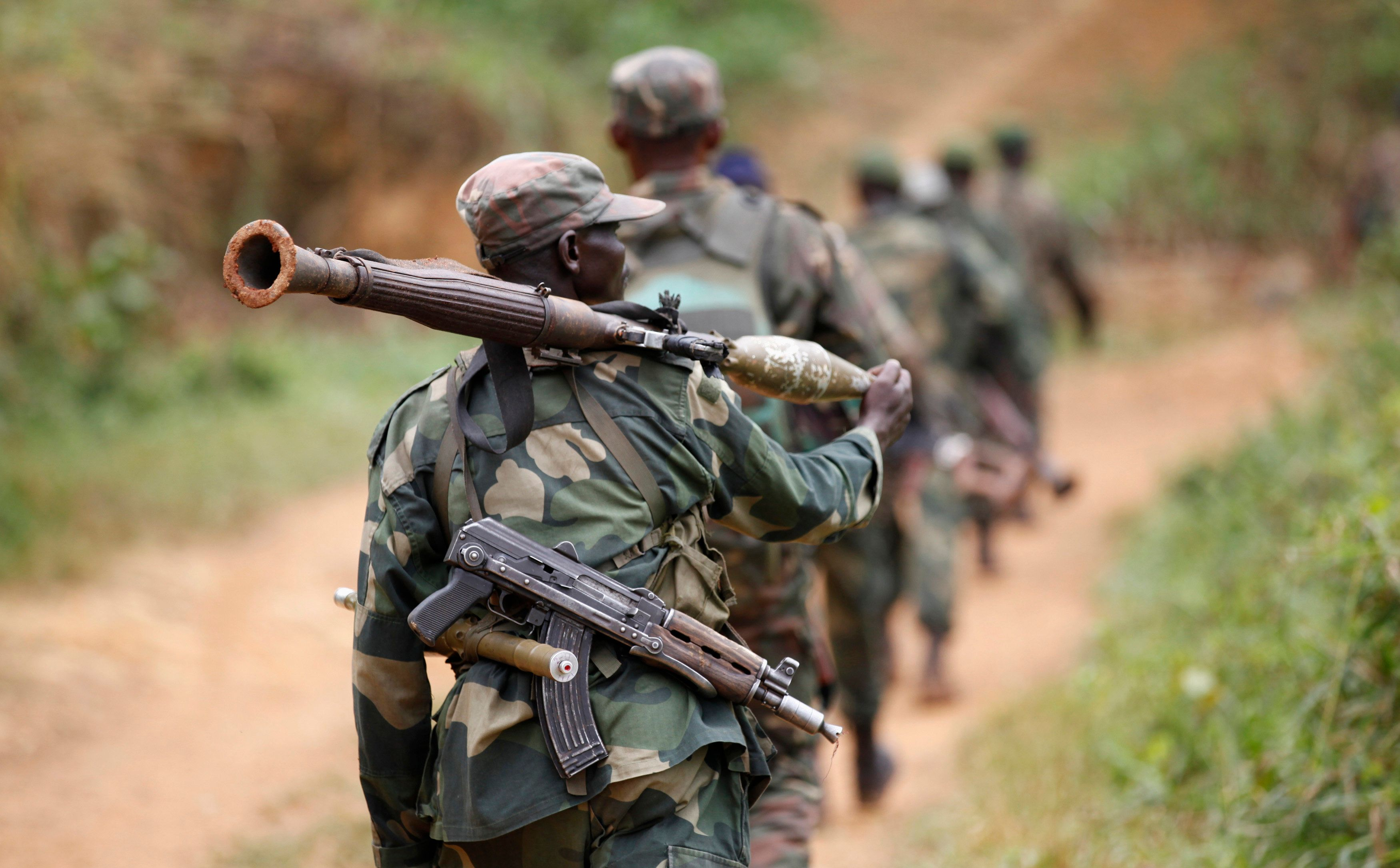 Democratic Republic of Congo military personnel (FARDC) patrol against the Allied Democratic Forces (ADF) and the National Army for the Liberation of Uganda (NALU) rebels near Beni in North-Kivu province, December 31, 2013. The Democratic Republic of Congo is struggling to emerge from decades of violence and instability, particularly in its east, in which millions of people have died, mostly from hunger and disease. A 21,000-strong United Nations peacekeeping mission (MONUSCO) is stationed in the country. REUTERS/Kenny Katombe (DEMOCRATIC REPUBLIC OF CONGO - Tags: POLITICS CIVIL UNREST CONFLICT MILITARY)