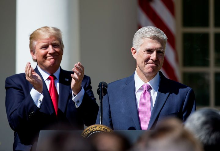 President Donald Trump celebrates his first confirmed judge, Neil Gorsuch, now on the Supreme Court.