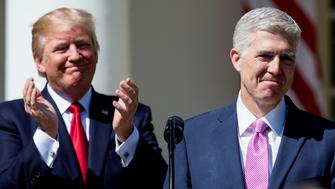 WASHINGTON, DC - APRIL 10:  U.S. Supreme Court Justice Judge Neil Gorsuch speaks as President Donald Trump looks on during a ceremony in the Rose Garden at the White House April 10, 2017 in Washington, DC. Earlier in the day Gorsuch, 49, was sworn in as the 113th Associate Justice in a private ceremony at the Supreme Court. (Photo by Eric Thayer/Getty Images)