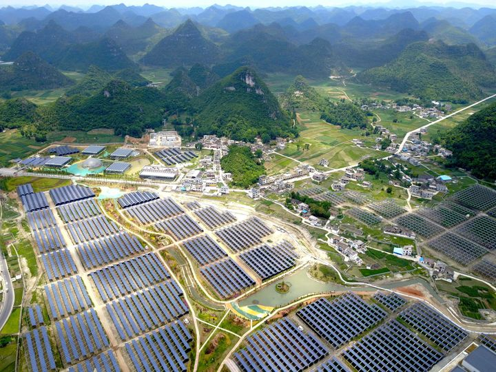 Greenhouses built with solar panels on their roofs, in Yang Fang village in Anlong, in China's southwest Guizhou province.&nb