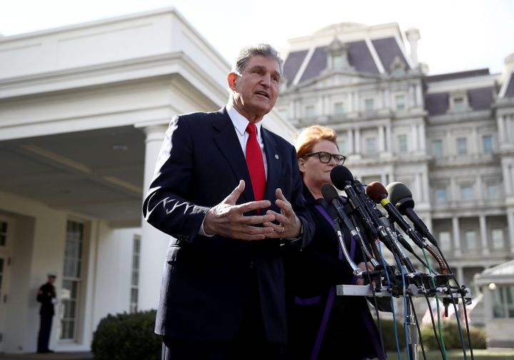 Sen. Joe Manchin (D-W.V.) and Sen. Heidi Heitkamp (D-N.D.) speak to members of the press following a meeting with President D