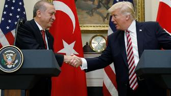Turkey's President Recep Tayyip Erdogan (L) shakes hands with U.S President Donald Trump as they make statements to reporters in the Roosevelt Room of the White House in Washington, U.S. May 16, 2017. REUTERS/Kevin Lamarque