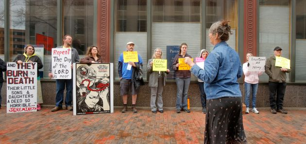 Anti-abortion protestors stand outside a Portland, Maine, abortion clinic in