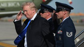 US President Donald Trump salutes a military aide upon arrival at Newark Liberty Airport in Newark, New Jersey on June 9, 2017.  Trump is heading to his Bedminster, New Jersey golf club to spend the weekend. / AFP PHOTO / MANDEL NGAN        (Photo credit should read MANDEL NGAN/AFP/Getty Images)