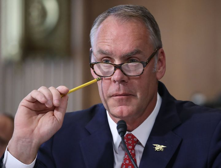 Interior Secretary Ryan Zinke listens to a question during a Senate Energy and Natural Resources Committee hearing on Capitol