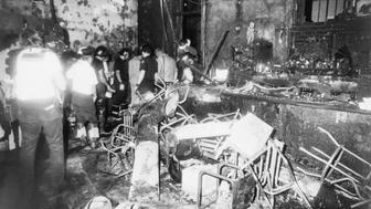 Firemen walk through the charred ruins of the Upstairs Bar 6/24 in the French Quarter where 29 persons trapped by a fire, died.