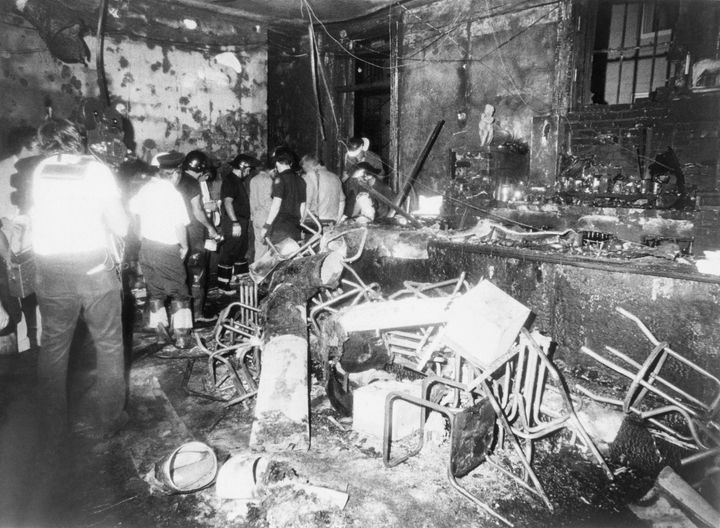 Investigators examine the charred ruins of the UpStairs Lounge bar.