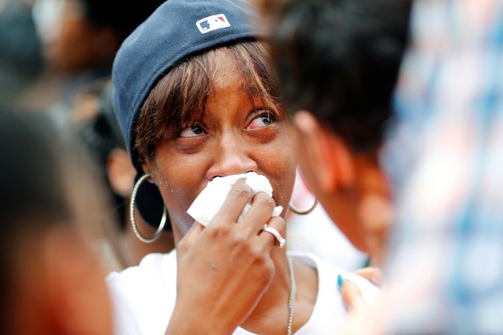 Diamond Reyonlds, the girlfriend of Philando Castile who was in the car with her then 4-year-old daughter, is comforted at a