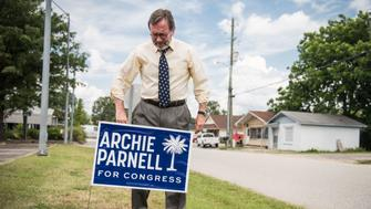 BISHOPVILLE, SC - JUNE 19: Democratic congressional candidate Archie Parnell places a campaign sign in the grass June 19, 2017 in Bishopville, South Carolina. Voters will choose between Parnell and Republican candidate Ralph Norman tomorrow in a special election for South Carolina's 5th Congressional District House seat. (Photo by Sean Rayford/Getty Images)