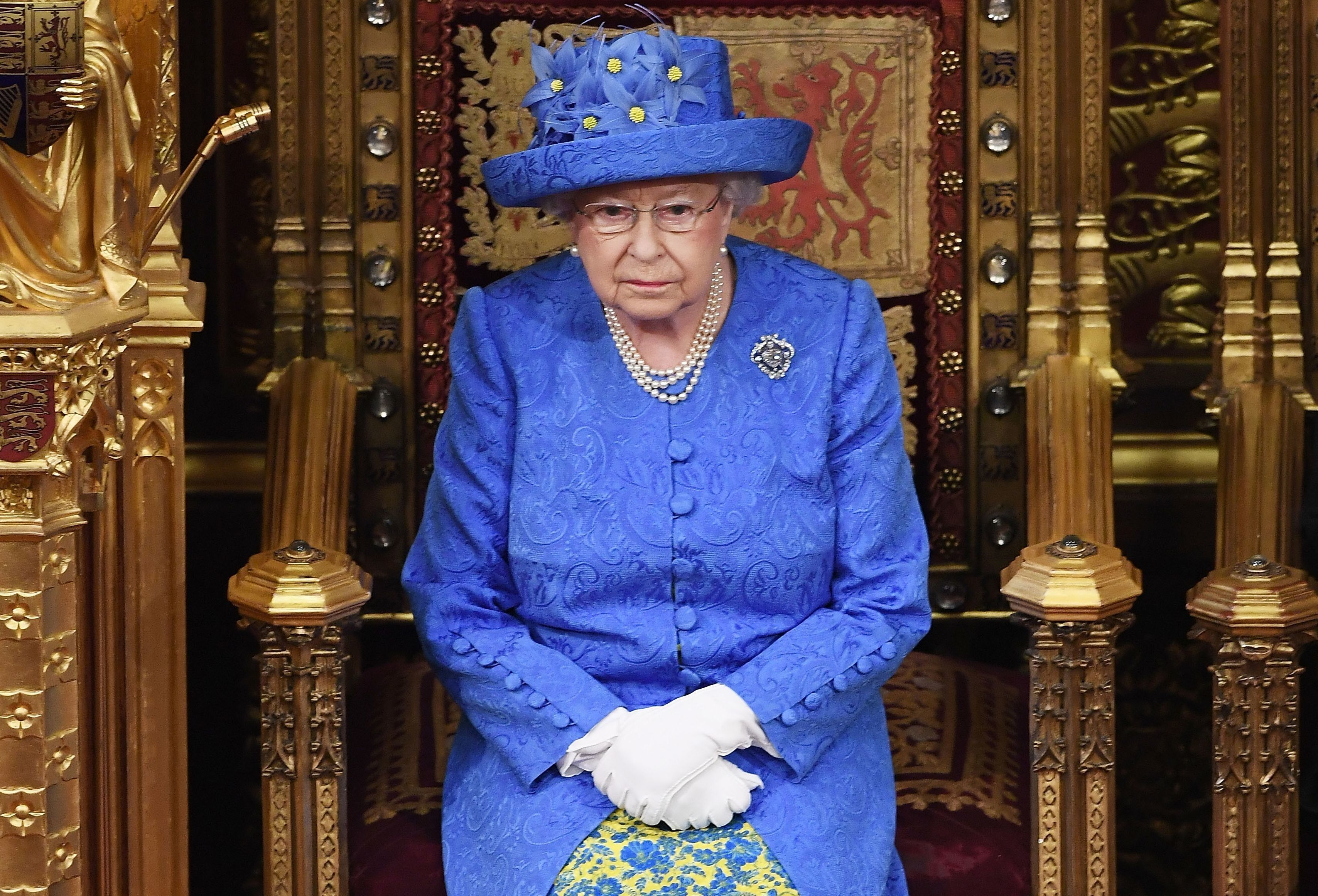 Britain's Queen Elizabeth II attends the State Opening of Parliament in the House of Lords at the Houses of Parliament in London on June 21, 2017.  Queen Elizabeth II will formally open parliament and announce the British government's legislative programme on Wednesday, two days later than planned. The state opening, a ceremony full of pomp in which the monarch reads out the Queen's Speech detailing the government's programme for the coming year, was due to take place on June 19, but was delayed after Britain's Prime Minister Theresa May's Conservative party lost their majority in the House of Commons in the June 8 election. / AFP PHOTO / POOL / Carl Court        (Photo credit should read CARL COURT/AFP/Getty Images)