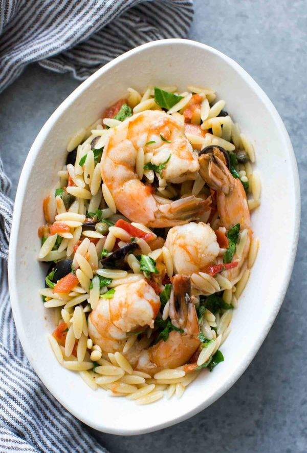 "<strong>Get the <a href=""http://www.simplyrecipes.com/recipes/shrimp_with_olives_tomatoes_and_orzo/"" target=""_blank"">Shrimp w"