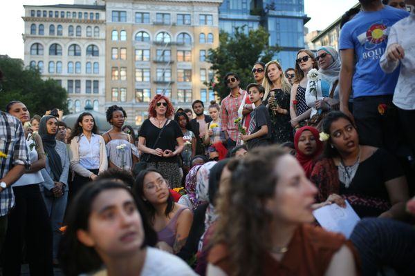 People attend a vigil in Union Square in New York City.