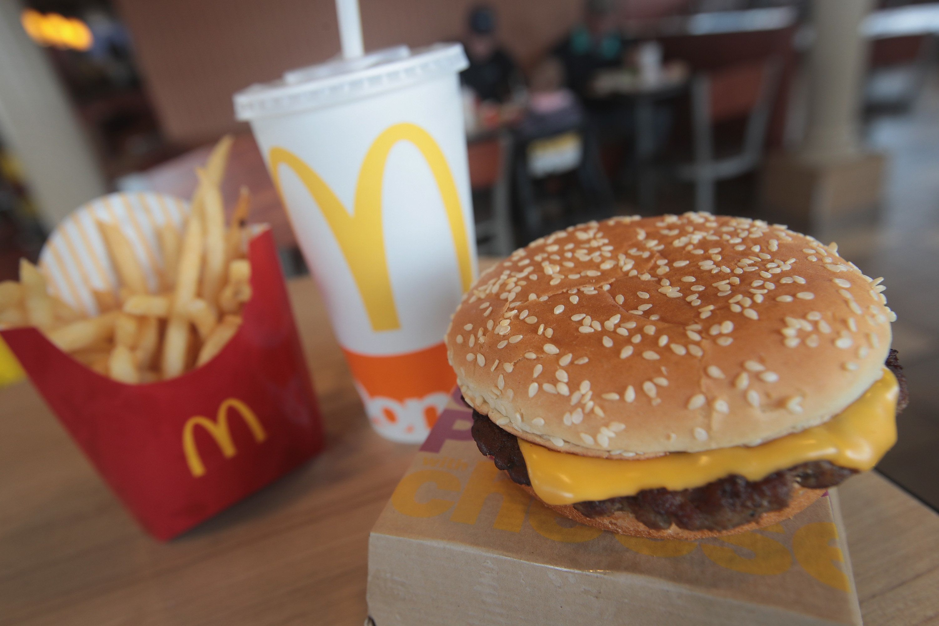 EFFINGHAM, IL - MARCH 30:  A Quarter Pounder hamburger is served at a McDonald's restaurant on March 30, 2017 in Effingham, Illinois. McDonald's announced today that it will start making the burger with fresh beef patties instead of the frozen beef that it currently uses.  (Photo Illustration by Scott Olson/Getty Images)