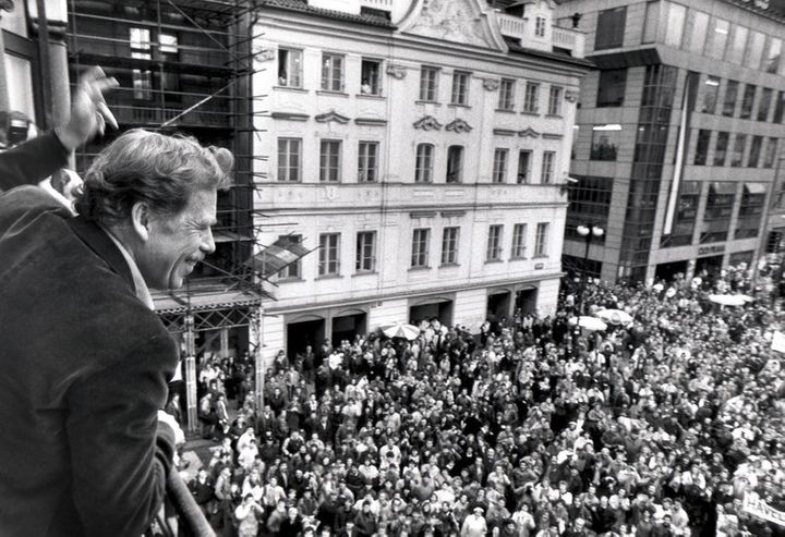 Presidential candidate Vaclav Havel waving to his supporters from a balcony in Prague on December 19 1989.