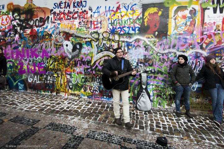 The John Lennon Wall in Prague, where some gather at dusk to sing and express their freedom.