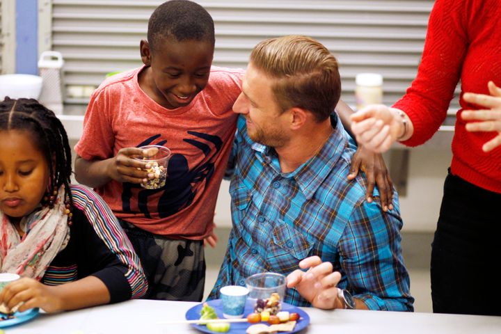 Ryan Graves eats with fourth grader Frederick Dozier during Cooking Matters, a nutrition class at Glen Park Elementary School