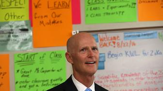 MIAMI, FL - AUGUST 22:  Florida Governor Rick Scott visits Jose De Diego Middle School on the first day of school in the Wynwood neighborhood where the mosquito born Zika virus has been found, August 22, 2016 in Miami, Florida. Miami's Wynwood neighborhood along with Miami Beach have been found to have cases of people with the mosquito born Zika virus as South Florida continues to work on controlling the outbreak.  (Photo by Joe Raedle/Getty Images)