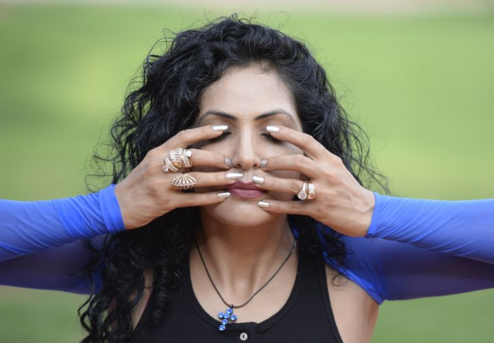 Indian celebrity yoga instructor Simran Ahuja poses for a photograph during an event to mark International Yoga Day in Hydera
