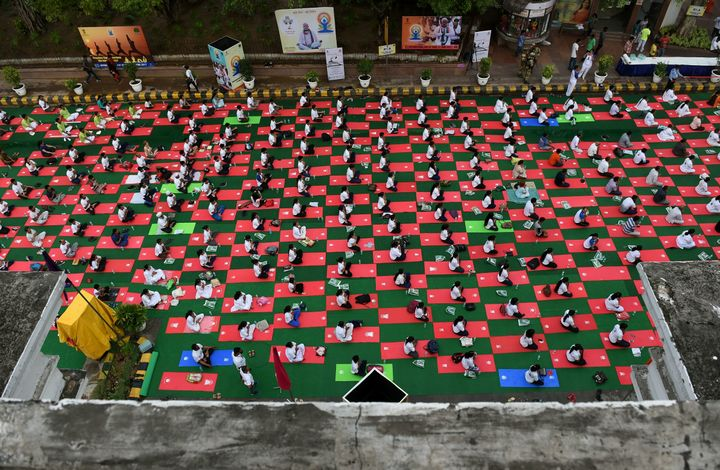 Indian yoga practitioners participate in a mass yoga session on International Yoga Day in New Delhi.