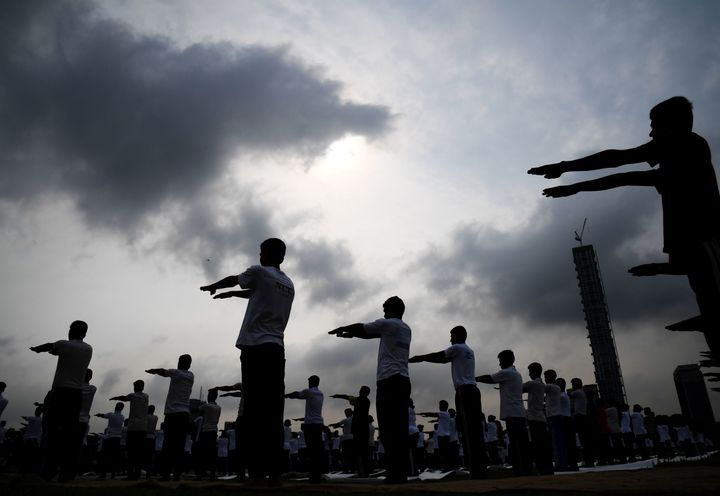 Members of India's National Cadet Corps (NCC) take part in a mass yoga session to mark International Yoga Day on The Brigade