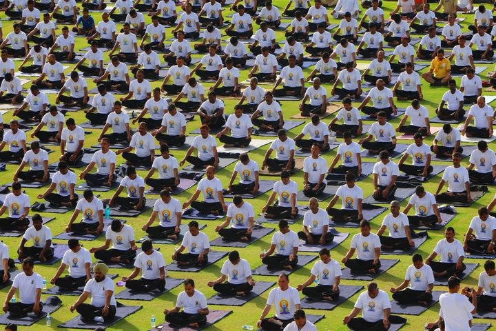 Yoga enthusiasts take part in a yoga session during the 3rd International Yoga Day at SMS stadium in Jaipur, Rajasthan, India