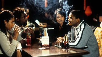 Larenz Tate and Nia Long having drinks with another couples in a scene from the film 'Love Jones', 1997. (Photo by Addis Wechsler Pictures/Getty Images)