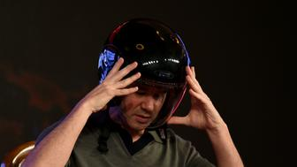 Co-founder and Chief Executive Officer (CEO) of US tranportation company Uber Travis Kalanick wears a helmet as he speaks at an event in New Delhi on December 16, 2016. / AFP / MONEY SHARMA        (Photo credit should read MONEY SHARMA/AFP/Getty Images)