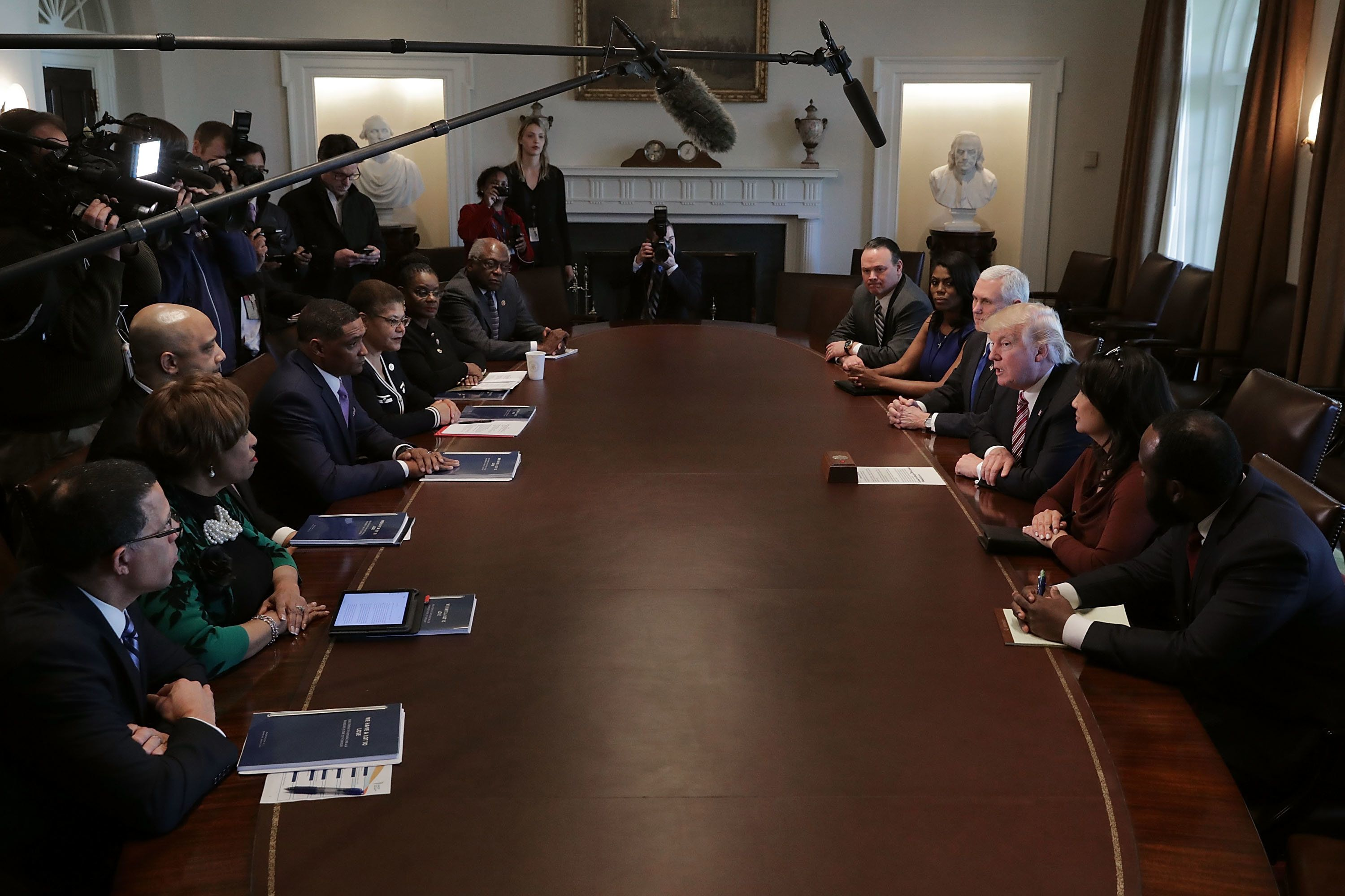 WASHINGTON, DC - MARCH 22:  (AFP OUT) U.S. President Donald Trump (3rd R) is joined by Vice President Mike Pence, White House Director of Communications for the Office of Public Engagement and Intergovernmental Affairs Omarosa Manigault and other staff members during a meeting with the Congressional Black Caucus Executive Committee in the Cabinet Room at the White House March 22, 2017 in Washington, DC. During the 2016 presidential campaign, Trump asked African Americans to support him, saying, 'You're living in poverty, your schools are no good, you have no jobs, 58 percent of your youth is unemployed -- what the hell do you have to lose?'  (Photo by Chip Somodevilla/Getty Images)