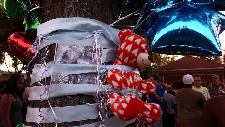 A teddy bear is seen on a tree during a commemoration ceremony held for Sylville Smith, who was shot and killed by a police o