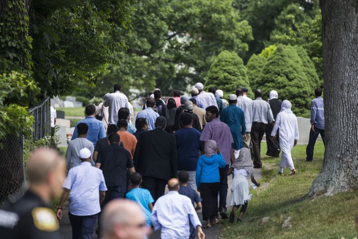 Mourners walk into Sterling Cemetery where Nabra Hassanen, who was killed Sunday, will be laid to rest in Sterling, Virg