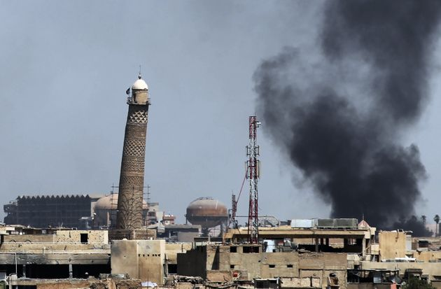 Smoke is seen billowing from Mosul's Old City earlier this month during the ongoing offensive by Iraqi