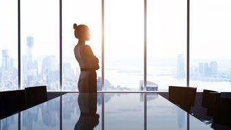 woman looking at modern city
