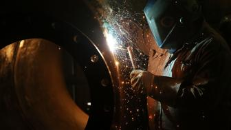 ANDREWS, TX - JANUARY 20:  A welder for Stewarts Inc., an oilfield service company, works on a tank that will be used in the fracking industry in the Permian Basin oil field on January 20, 2016 in the oil town of Andrews, Texas. Despite recent drops in the price of oil, many residents of Andrews, and similar towns across the Permian, are trying to take the long view and stay optimistic. The Dow Jones industrial average plunged 540 points on Wednesday after crude oil plummeted another 7% and crashed below $27 a barrel.  (Photo by Spencer Platt/Getty Images)