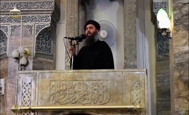Abu Bakr al-Baghdadi speaks from the Grand al Nuri Mosque in Mosul in June