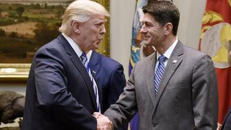U.S. President Donald Trump, left, shakes hands with U.S. House Speaker Paul Ryan, a Republican from Wisconsin, after a meeting with House and Senate leadership in the Roosevelt Room of the White House in Washington, D.C., U.S., on Tuesday, June 6, 2017. Trump is bringing lawmakers to the White House in hopes of kick-starting his legislative agenda while Washington focuses on the latest twists and turns in the Russia investigation. Photographer: Olivier Douliery/Pool via Bloomberg