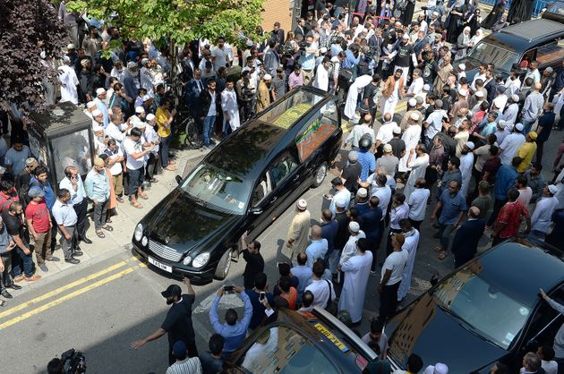 The coffin of Mohammad Alhajali, a victim of the deadly Grenfell Tower blaze, is taken from the east...