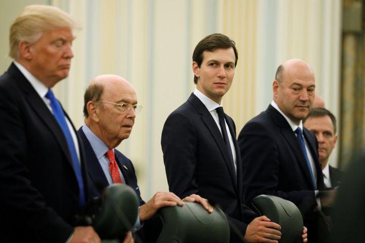 White House senior advisor Jared Kushner, center, with President Donald Trump and Commerce Secretary Wilbur Ross to his left
