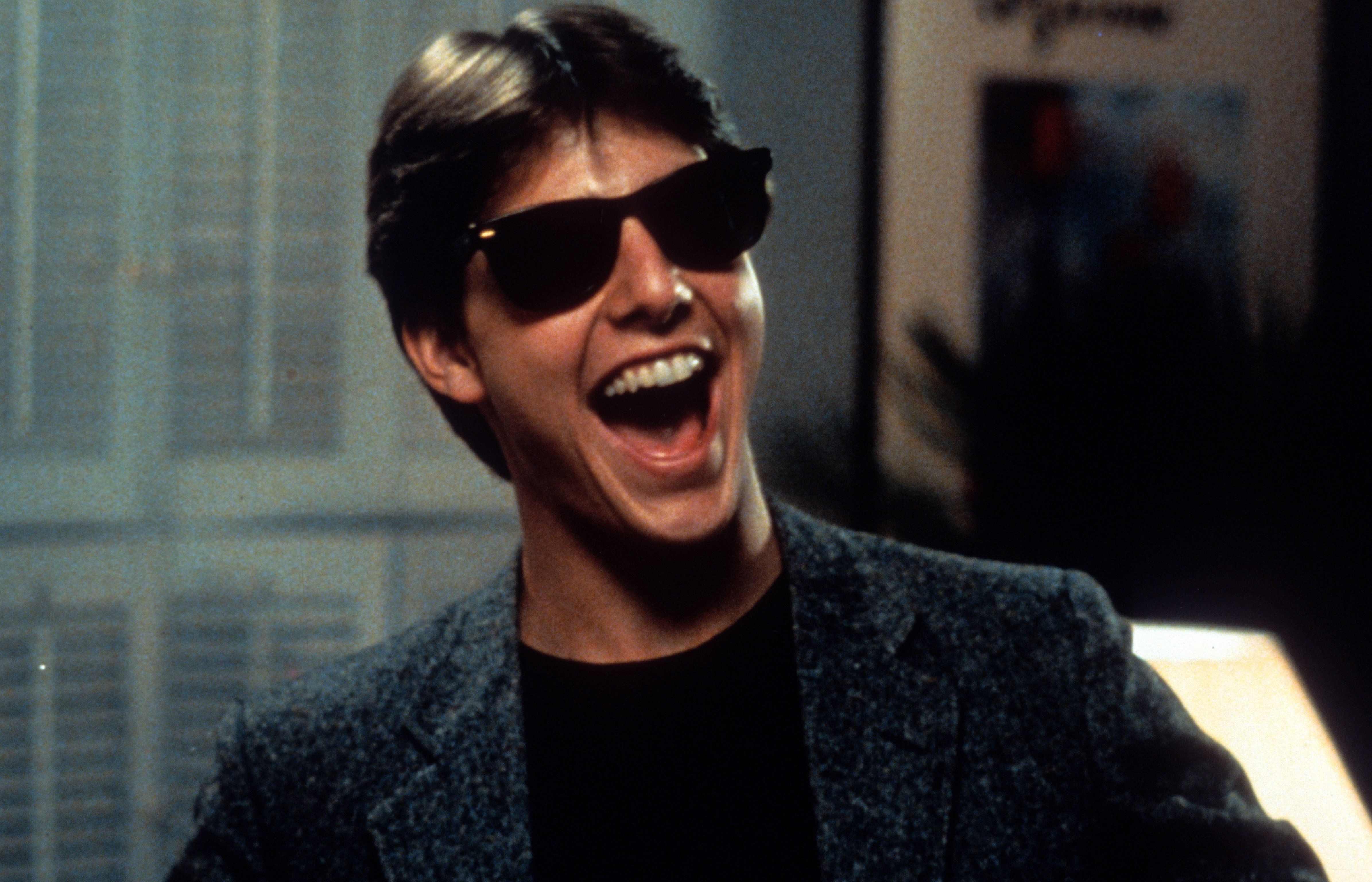 Tom Cruise laughs in a scene from the film 'Risky Business', 1983. (Photo by Warner Brothers/Getty Images)