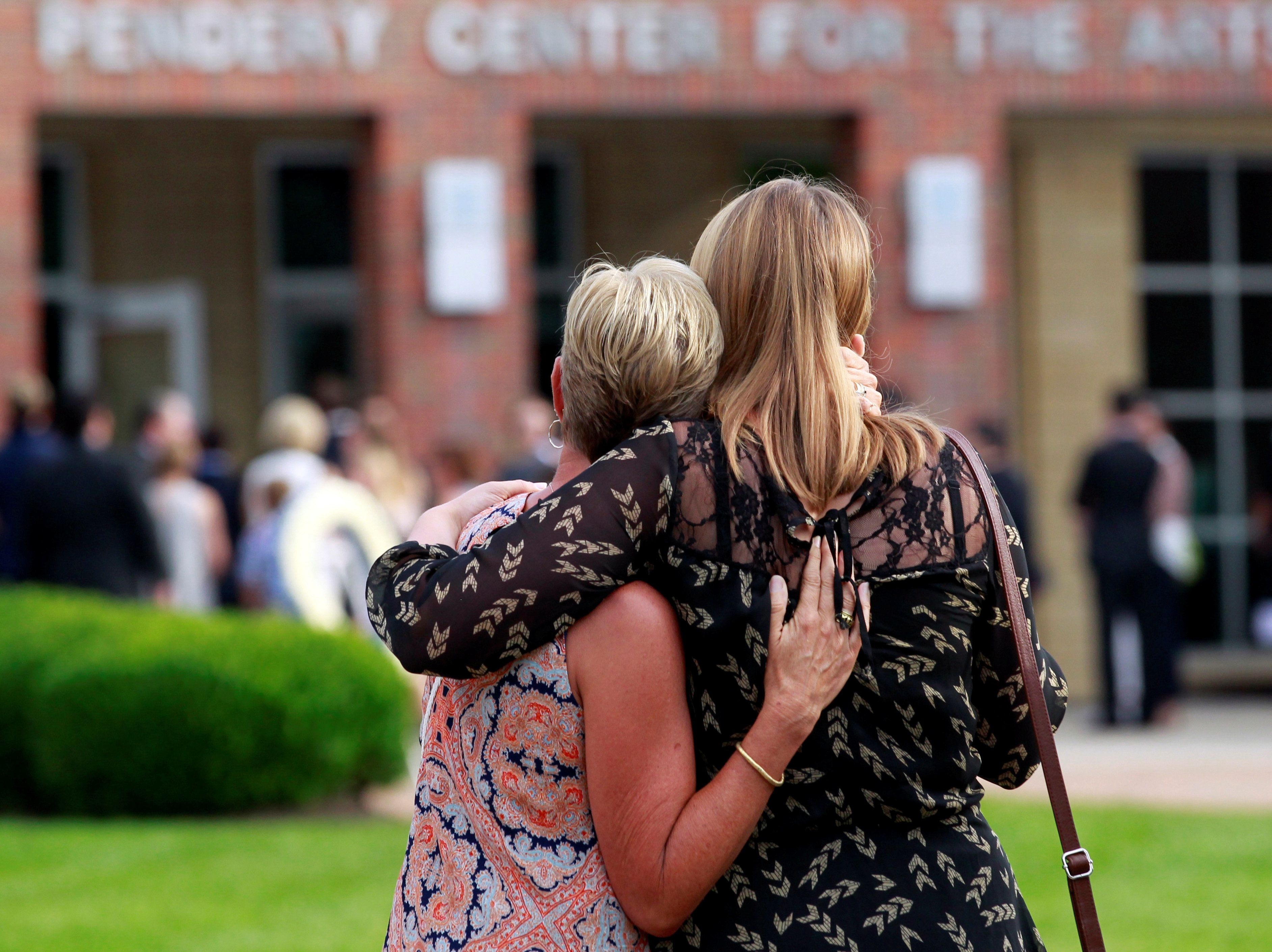 Mourners stand out side the art center before a funeral service for Otto Warmbier, who died after his release from North Korea, at Wyoming High School in Wyoming, Ohio, U.S. June 22, 2017.  REUTERS/John Sommers II       TPX IMAGES OF THE DAY