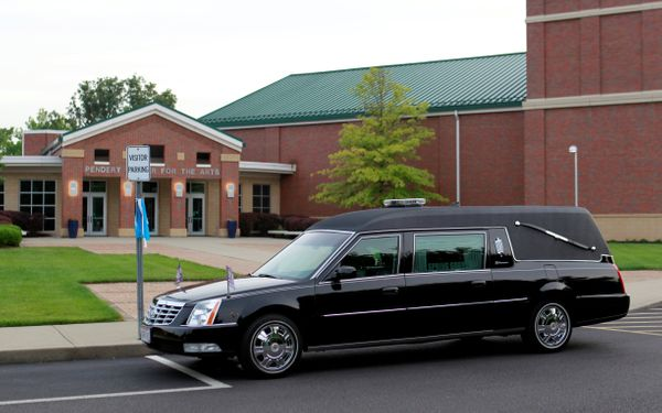The hearse arrives carrying the body of Otto Warmbier.