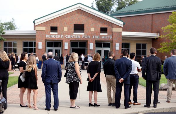 People lined up outside Wyoming High School for Warmbier's funeral.