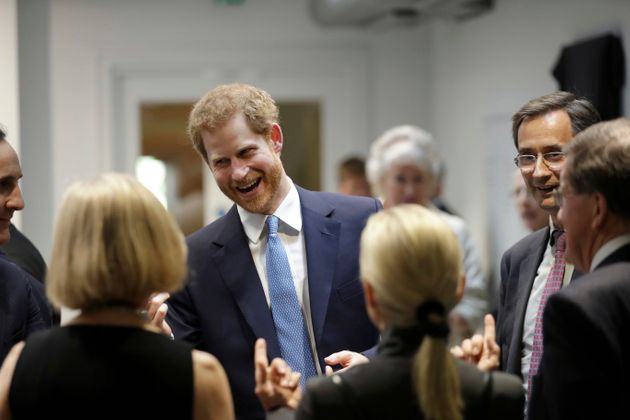 Prince Harry speaks to people during his visit to Chatham House, the Royal Institute of International...