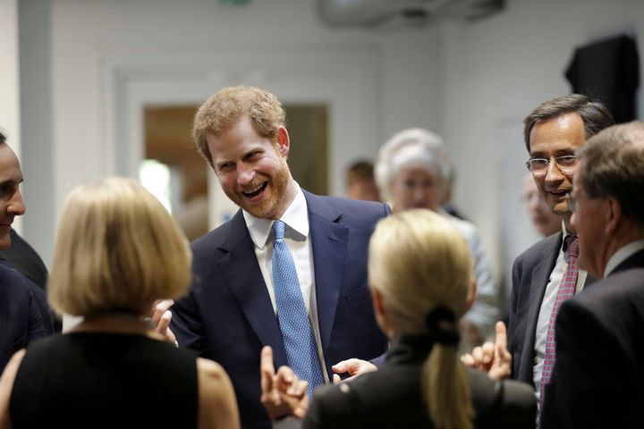 Prince Harry speaks to people during his visit to Chatham House, the Royal Institute of International Affairs on June 15 in London, England