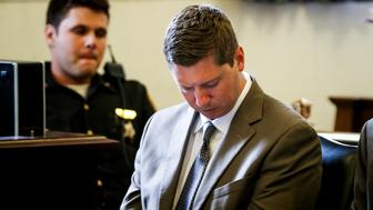 Former University of Cincinnati police officer Raymond Tensing looks away as the shooting victim Sam Dubose's autopsy photos are presented during the fifth day of his retrial in Cincinnati, Ohio, U.S., June 14, 2017.    REUTERS/Cara Owsley/The Enquirer/Pool