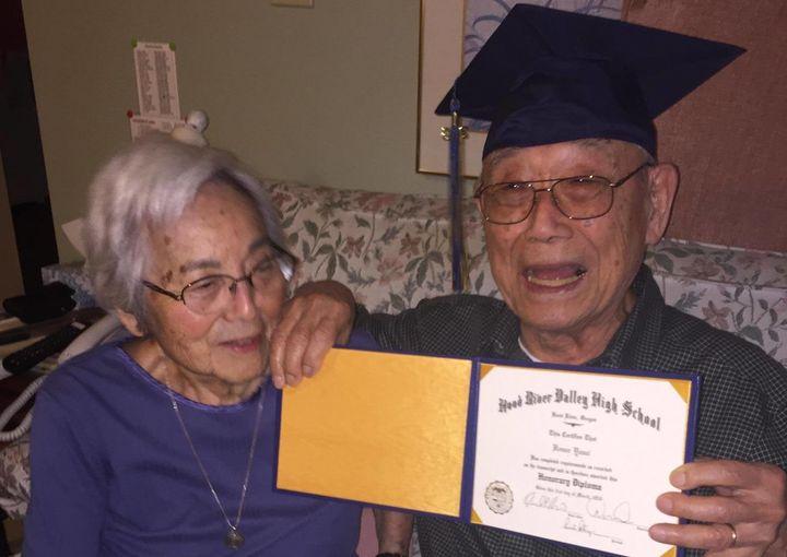 Mygrandfather, Homer Yasui, shows off his diploma as my grandmother, Miki Yasui, looks on.