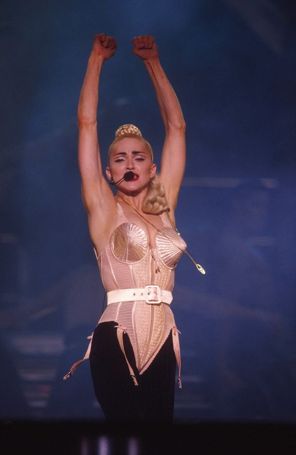 "Madonna debuted the infamous cone bra, designed by John Paul Gaultier, on tour in Japan. He told The Cut his<a href=""https://"